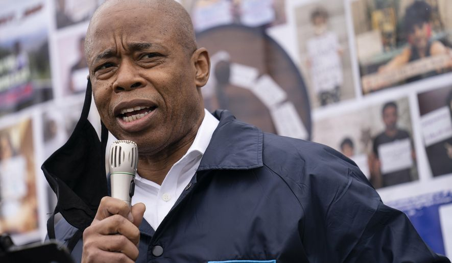 In this March 24, 2021, photo, Eric Adams, Brooklyn Borough President and a Democratic mayoral candidate, speaks during a 'I Want My Miracle Back' rally, in the Bronx borough of New York. Adams, a former police officer, is betting that a spike in shootings during the coronavirus pandemic — including a shooting that injured three bystanders in Times Square last weekend — will boost his appeal. (AP Photo/John Minchillo) **FILE**