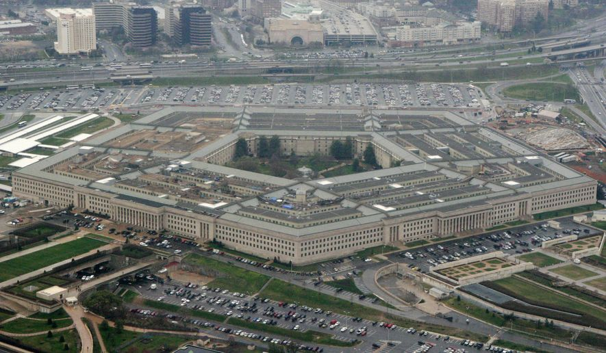 This March 27, 2008, file photo, shows the Pentagon in Washington. Reports of sexual assaults across the U.S. military increased by a very small amount in 2020, a year when troops were largely locked down for months as bases around the world grappled with the COVID-19 pandemic, according to U.S. officials. (AP Photo/Charles Dharapak, File)