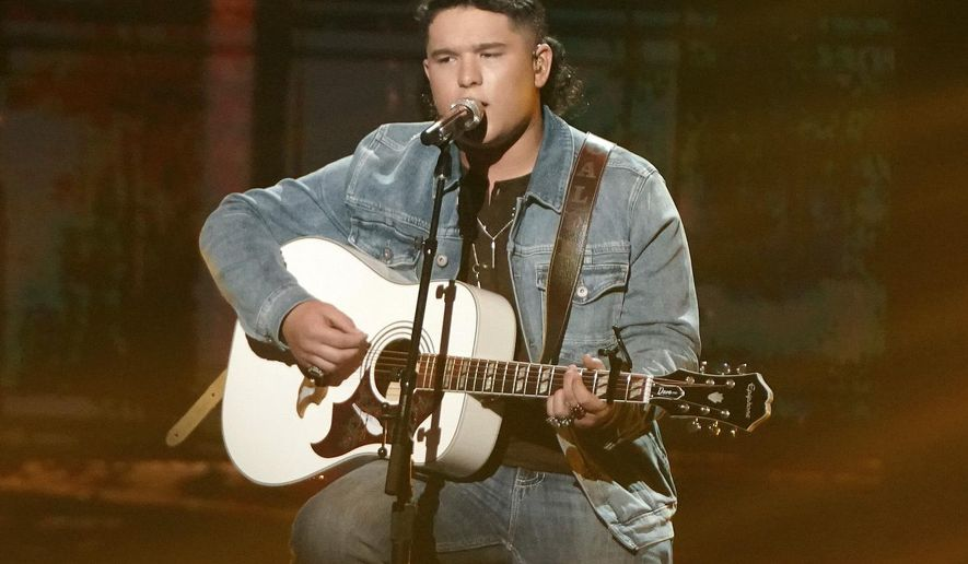 """This image released by ABC shows Caleb Kennedy performing on the singing competition series """"American Idol,"""" in Los Angeles that aired May 9. Kennedy has dropped out of the singing competition after a video circulated showing him sitting next to someone wearing what appears to be a Ku Klux Klan hood. Kennedy, advanced into the Top 5, apologized for the video on Twitter and Instagram on Wednesday, saying """"it displayed actions that were not meant to be taken in that way.""""  (Eric McCandless/ABC via AP)"""