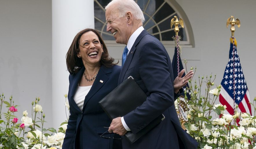 """Vice President Kamala Harris and President Joe Biden smile and walk off after speaking about updated guidance on mask mandates, in the Rose Garden of the White House, Thursday, May 13, 2021, in Washington. The Centers for Disease Control and Prevention is easing mask-wearing guidance for fully vaccinated people, allowing them to stop wearing masks outdoors in crowds and in most indoor settings. The new guidance announced Thursday is a major step toward returning to pre-pandemic life. President Joe Biden calls it """"a great day for America.""""  (AP Photo/Evan Vucci)"""