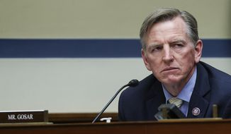 Rep. Paul Gosar, R-Ariz., listens during a House Oversight and Reform Committee regarding the on Jan. 6 attack on the U.S. Capitol, on Capitol Hill in Washington, Wednesday, May 12, 2021. (Jonathan Ernst/Pool via AP)
