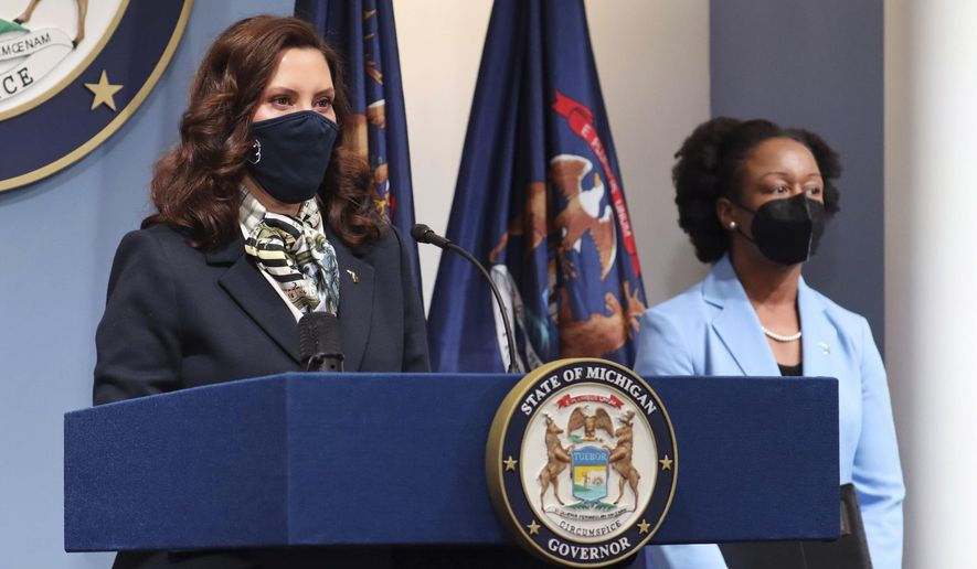 In this photo provided by the Michigan Office of the Governor, Gov. Gretchen Whitmer addresses the state during a speech, Wednesday, May 12, 2021, in Lansing, Mich. (Michigan Office of the Governor via AP) **FILE**