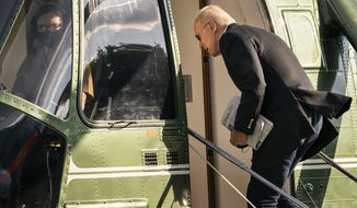 President Joe Biden boards Marine One on the Ellipse near the White House in Washington, Saturday, May 15, 2021. (AP Photo/Manuel Balce Ceneta)