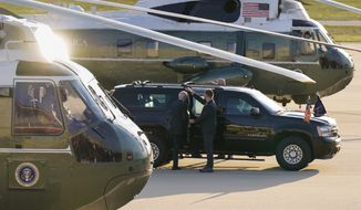 President Joe Biden boards his motorcade vehicle as he and and first lady Jill Biden arrive on Marine One, Saturday, May 15, 2021, at Delaware Air National Guard Base in New Castle, Del. (AP Photo/Carolyn Kaster)