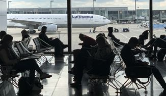 Passengers wait for their Lufthansa flight at the airport in Frankfurt, Germany, Saturday, May 15, 2021. (AP Photo/Martin Meissner) ** FILE **