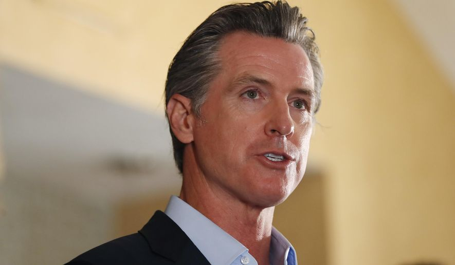 In this Tuesday, May 11, 2021, file photo, California Gov. Gavin Newsom speaks at a news conference at the Kearney Vista Apartments in San Diego, about a $12 billion package bolstering the state's response to the homelessness crisis. A fading coronavirus crisis and an astounding windfall of tax dollars have reshuffled California's emerging recall election, allowing Democratic Gov. Newsom to talk of a mask-free future and propose billions in new spending for schools and businesses as he looks to fend off Republicans who depict him as a foppish failure. (K.C. Alfred/The San Diego Union-Tribune via AP, File)