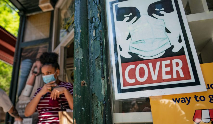 The sight of protective masks in public will start to fade away as totally vaccinated Americans feel safe to go out without them. (Associated Press/File)