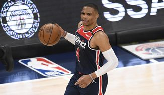 Washington Wizards guard Russell Westbrook dribbles the ball during the first half of an NBA basketball game against the Cleveland Cavaliers, Friday, May 14, 2021, in Washington. (AP Photo/Nick Wass) **FILE**