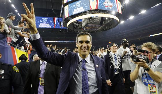 Villanova head coach Jay Wright celebrates after the NCAA Final Four tournament college basketball championship game against North Carolina, Monday, April 4, 2016, in Houston. Wright is among those announced Sunday, May 16, 2021 as the 2021 class for the Naismith Memorial Basketball Hall of Fame. (AP Photo/David J. Phillip, file) **FILE**