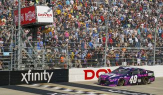 Alex Bowman gets the checker flag as he finishes first during a NASCAR Cup Series auto race at Dover International Speedway, Sunday, May 16, 2021, in Dover, Del. Alex Bowman wins the race. (AP Photo/Chris Szagola)