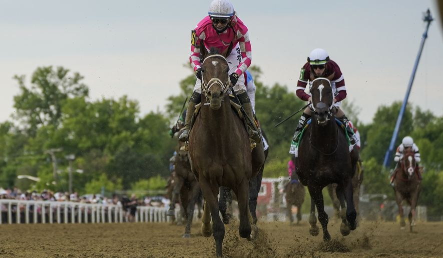 Flavien Prat atop Rombauer wins the 146th Preakness Stakes horse race at Pimlico Race Course, Saturday, May 15, 2021, in Baltimore. (AP Photo/Julio Cortez) **FILE**