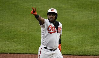 Baltimore Orioles' Maikel Franco gestures after hitting a two-run home run off New York Yankees relief pitcher Wandy Peralta (58) during the seventh inning of a baseball game, Sunday, May 16, 2021, in Baltimore. Orioles' Pedro Severino scored on the play. (AP Photo/Julio Cortez)
