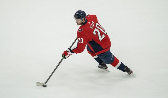 Washington Capitals center Lars Eller (20) in action during the first period of Game 2 of an NHL hockey Stanley Cup first-round playoff series against the Boston Bruins, Monday, May 17, 2021, in Washington. (AP Photo/Alex Brandon)