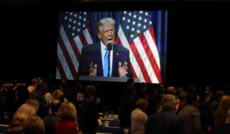 FILE - In this Monday, Aug. 24, 2020 file photo, a screen displays President Donald Trump as he speaks on stage during the first day of the Republican National Committee convention in Charlotte, N.C. On Monday, May 17, 2021, GOP officials announced that the former president will speak at the June 5, 2021 state convention dinner in Greenville. (AP Photo/Evan Vucci)