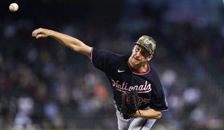 Washington Nationals starting pitcher Erick Fedde throws a pitch against the Arizona Diamondbacks during the first inning of a baseball game Sunday, May 16, 2021, in Phoenix. (AP Photo/Ross D. Franklin)