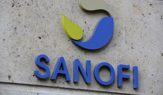 In this Nov. 30, 2020, file photo, the logo of French drugmaker Sanofi is pictured at the company's headquarters, in Paris. Sanofi and GlaxoSmithKline's potential COVID-19 vaccine triggered strong immune responses in all adult age groups in preliminary trials, boosting optimism that the shot may join the fight against the pandemic by the end of this year. (AP Photo/Thibault Camus, File)