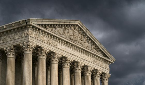 In this June 20, 2019, photo, the Supreme Court is seen in Washington as a storm rolls in. (AP Photo/J. Scott Applewhite) **FILE**