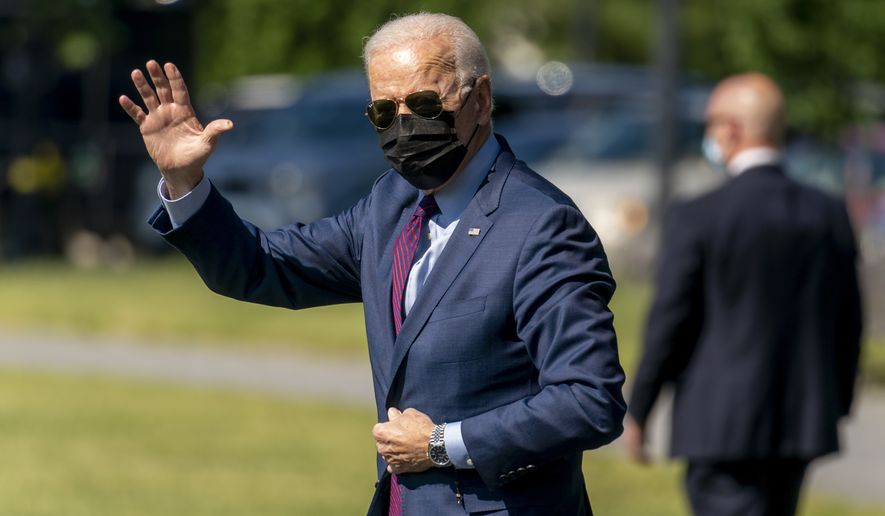 President Joe Biden waves as he walks towards Marine One on the Ellipse at the White House in Washington, Tuesday, May 18, 2021, for a short trip to Andrews Air Force Base, Md., and then on to Detroit to visit the Ford Rouge Electric Vehicle Center in Dearborn, Mich. (AP Photo/Andrew Harnik)