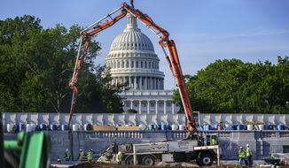 A concrete pump frames the Capitol Dome during renovations and repairs to Lower Senate Park on Capitol Hill in Washington, Tuesday, May 18, 2021. President Joe Biden hopes to pass a massive national infrastructure plan by this summer, but Democrats and Republicans in Congress appear divided over his proposal for $2.3 trillion in spending to upgrade the nation's crumbling infrastructure. (AP Photo/J. Scott Applewhite)