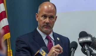 Pasquotank County District Attorney Andrew Womble answers questions from reporters after announcing he will not charge deputies in the April 21 fatal shooting of Andrew Brown Jr. during a news conference Tuesday, May 18, 2021, at the Pasquotank County Public Safety building in Elizabeth City, N.C. (Travis Long/The News & Observer via AP)
