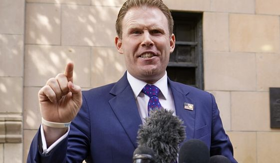 In this April 28, 2021 file photo, Andrew Giuliani, son of former New York Mayor Rudy Giuliani, speaks to reporters outside the building where his father lives, in New York. Andrew Giuliani announced Tuesday, May 18, 2021, that he is seeking the Republican nomination for governor of New York, potentially setting up a battle with third-term incumbent Democrat Andrew Cuomo.(AP Photo/Mary Altaffer, File)