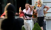In this June 28, 2020 file photo, armed homeowners Mark and Patricia McCloskey, standing in front their house along Portland Place confront protesters marching to St. Louis Mayor Lyda Krewson's house in the Central West End of St. Louis. Mark McCloskey, a St. Louis personal injury lawyer who gained national attention after he and his wife waved guns at racial injustice protesters who marched near their home last summer, is on the verge of a 2022 Senate run.(Laurie Skrivan/St. Louis Post-Dispatch via AP, File)