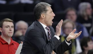 In this Jan. 30, 2019, file photo, Louisville assistant coach Dino Gaudio cheers on the team against Wake Forest during the second half of an NCAA college basketball game in Winston-Salem, N.C. Federal authorities have charged Gaudio with attempting to extort the university after his dismissal from the team. Gaudio threatened to go to the media with alleged NCAA violations by the team, according to a charging document filed in federal court. (AP Photo/Chuck Burton, File) **FILE**