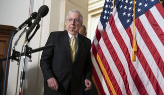 Senate Minority Leader Mitch McConnell of Ky., reacts after bumping into an American flag before speaking to the media, Tuesday, May 18, 2021, after a meeting of Senate Republicans on Capitol Hill in Washington. (AP Photo/Jacquelyn Martin) **FILE**