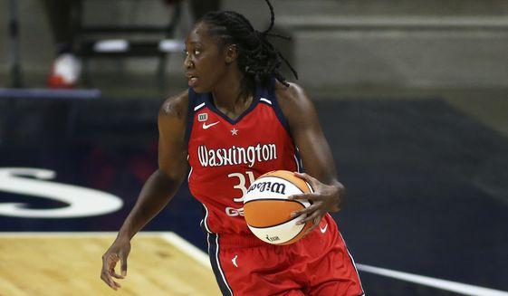 Washington Mystics center Tina Charles (31) in action during a WNBA basketball game, Saturday, May 15, 2021, in Washington. (AP Photo/Daniel Kucin Jr.) **FILE**