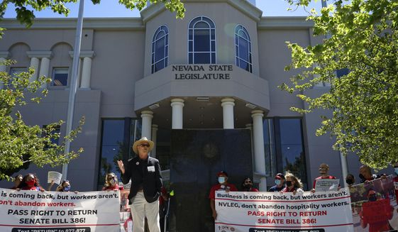 In this file photo, Phil Jaynes, the president of the International Alliance of Theatrical Stage Employees Local 720, addresses demonstrators in front of the Nevada statehouse on Tuesday, May 18, 2021 in Carson City, Nev. Labor groups want state lawmakers to pass a bill guaranteeing workers laid off during the pandemic have a 'right to return' and get first priority when resorts and casinos need to rehire workers. (AP Photo/Samuel Metz)  **FILE**