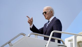 President Joe Biden points before boarding Air Force One at Quonset Point Air National Guard in North Kingstown, R.I., Wednesday, May 19, 2021, to travel back to Washington after attending the commencement for the United States Coast Guard Academy in New London, Conn. (AP Photo/Andrew Harnik)