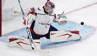 Washington Capitals goaltender Ilya Samsonov makes a save against the Boston Bruins during overtime of Game 3 of an NHL hockey Stanley Cup first-round playoff series, Wednesday, May 19, 2021, in Boston. (AP Photo/Charles Krupa) **FILE**