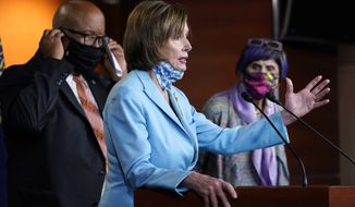 House Speaker Nancy Pelosi of Calif., center, flanked by Rep. Benny Thompson, D-Miss., left, and Rep. Rosa DeLauro, D-Conn., right, talks to reporters on Capitol Hill in Washington, Wednesday, May 19, 2021, about legislation to create an independent, bipartisan commission to investigate the Jan. 6 attack on the United States Capitol complex. Thompson is chairman of the House Homeland Security Committee and negotiated a bipartisan bill outlining a commission to investigate the Jan. 6 attack on the Capitol. (AP Photo/Susan Walsh)