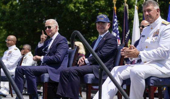 President Joe Biden, Homeland Security Secretary Alejandro Mayorkas, andAdm. Karl Schultz, Commandant of the Coast Guard, right, attend the commencement for the United States Coast Guard Academy in New London, Conn., Wednesday, May 19, 2021. (AP Photo/Andrew Harnik)
