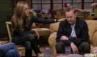 """Jennifer Aniston comforts fellow """"Friends"""" co-start Matthew Perry during the taping of the show's reunion special. (Image: YouTube, HBO Max, """"Friends"""" reunion special trailer screenshot)"""