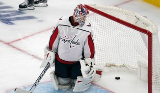 Washington Capitals goaltender Ilya Samsonov (30) looks back at the puck after giving up the game-winning goal to Boston Bruins right wing Craig Smith during a second overtime period of Game 3 of an NHL hockey Stanley Cup first-round playoff series, Wednesday, May 19, 2021, in Boston. The Bruins won 3-2. (AP Photo/Charles Krupa)