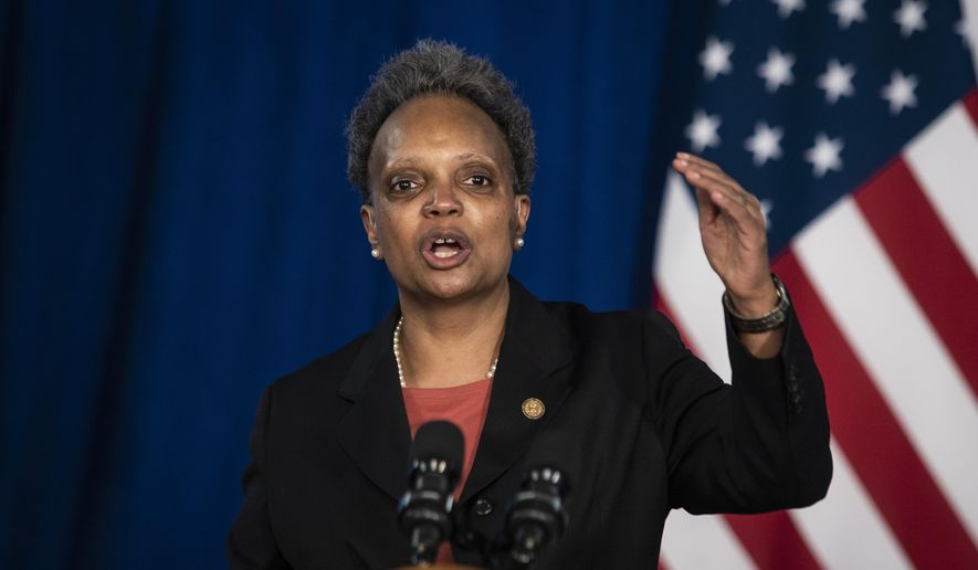 In this Thursday, April 15, 2021, file photo, Mayor Lori Lightfoot discusses the videos of 13-year-old Adam Toledo, who was fatally shot by a Chicago police officer, during a news conference at City Hall in Chicago. (Ashlee Rezin Garcia/Chicago Sun-Times via AP, File)