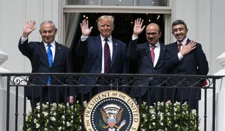 In this Tuesday, Sept. 15, 2020, file photo, Israeli Prime Minister Benjamin Netanyahu, left, U.S. President Donald Trump, Bahrain Foreign Minister Khalid bin Ahmed Al Khalifa and United Arab Emirates Foreign Minister Abdullah bin Zayed al-Nahyan pose for a photo on the Blue Room Balcony after signing the Abraham Accords during a ceremony on the South Lawn of the White House in Washington. The bloodshed in the Gaza Strip has unleashed a chorus of voices across Gulf Arab states that are fiercely critical of Israel and emphatically supportive of Palestinians. (AP Photo/Alex Brandon, File)