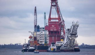 In this Jan. 14, 2021, file photo, tugboats get into position on the Russian pipe-laying vessel 'Fortuna' in the port of Wismar, Germany. The special vessel is being used for construction work on the German-Russian Nord Stream 2 gas pipeline in the Baltic Sea. Pressure is growing on President Joe Biden to take action to prevent the completion of a Russian gas pipeline to Europe that many fear will give the Kremlin significant leverage over U.S. partners and allies. (Jens Buettner/dpa via AP) ** FILE **