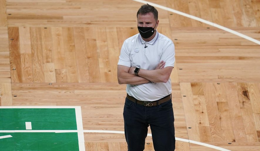 Washington Wizards head coach Scott Brooks stands on the court during a timeout in the second half of the team's NBA basketball Eastern Conference play-in game against the Boston Celtics, Tuesday, May 18, 2021, in Boston. (AP Photo/Charles Krupa)