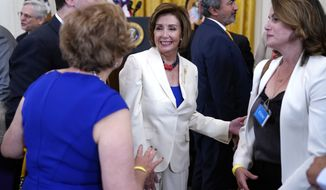 House Speaker Nancy Pelosi of Calif., arrives for the signing the COVID-19 Hate Crimes Act, in the East Room of the White House, Thursday, May 20, 2021, in Washington. (AP Photo/Evan Vucci)
