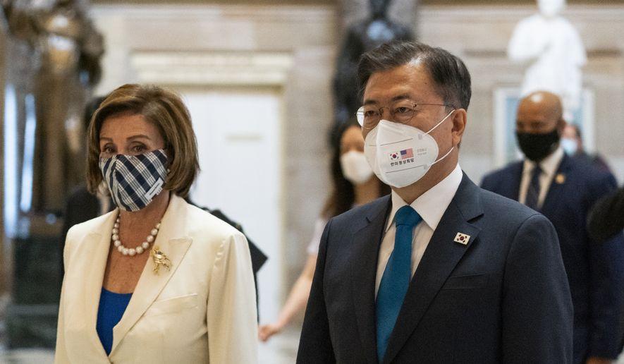South Korean President Moon Jae-in and House Speaker Nancy Pelosi of Calif., walk through Statuary Hall in the Capitol, Thursday, May 20, 2021, in Washington. (AP Photo/Manuel Balce Ceneta)