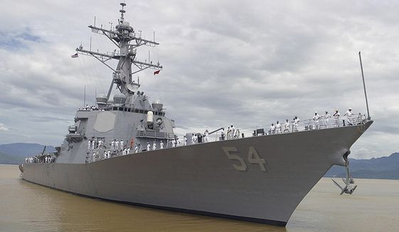 In this July 28, 2004, file photo, American sailors line the deck of the USS Curtis Wilbur, a guided missile destroyer as it arrives in Danang, Vietnam.  (AP Photo, File)  **FILE**