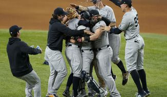 New York Yankees' Corey Kluber, third from left, is congratulated by teammates after throwing a no-hitter against the Texas Rangers in a baseball game in Arlington, Texas, Wednesday, May 19, 2021. (AP Photo/Tony Gutierrez)