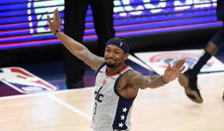 Washington Wizards guard Bradley Beal (3) reacts after he made a 3-point basket during the second half of the team's NBA basketball Eastern Conference play-in game against the Indiana Pacers, Thursday, May 20, 2021, in Washington. (AP Photo/Nick Wass)  **FILE**