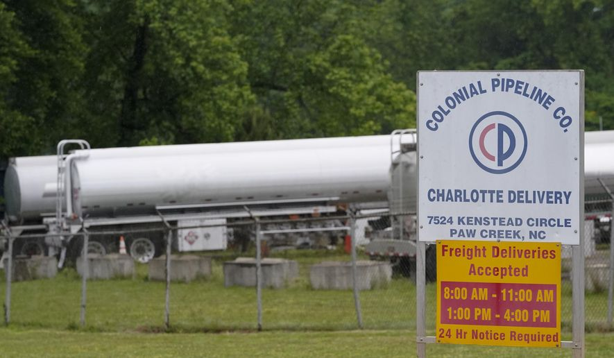 Tanker trucks are parked near the entrance of Colonial Pipeline Company Wednesday, May 12, 2021, in Charlotte, N.C. The operator of the nation's largest fuel pipeline has confirmed it paid $4.4 million to a gang of hackers who broke into its computer systems. That's according to a report from the Wall Street Journal. Colonial Pipeline's CEO Joseph Blount told the Journal that he authorized the payment after the ransomware attack because the company didn't know the extent of the damage. (AP Photo/Chris Carlson) ** FILE **
