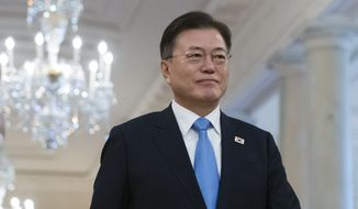 South Korean President Moon Jae-in arrives for a ceremony to present the Medal of Honor to U.S. Army Col. Ralph Puckett, with President Joe Biden, in the East Room of the White House, Friday, May 21, 2021, in Washington. (AP Photo/Alex Brandon)