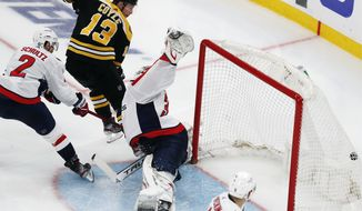 Boston Bruins' Charlie Coyle (13) scores on Washington Capitals goalie Ilya Samsonov (30) during the third period in Game 4 of an NHL hockey Stanley Cup first-round playoff series Friday, May 21, 2021, in Boston. (AP Photo/Michael Dwyer)