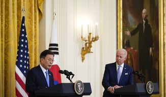 President Joe Biden listens as South Korean President Moon Jae-in speaks during a joint news conference in the East Room of the White House, Friday, May 21, 2021, in Washington. (AP Photo/Alex Brandon)