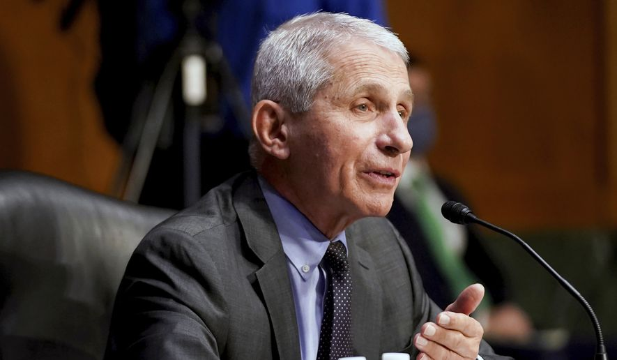 """Dr. Anthony Fauci, director of the National Institute of Allergy and Infectious Diseases, testifies during a Senate Health, Education, Labor, and Pensions hearing to examine an update from Federal officials on efforts to combat COVID-19, Tuesday, May 11, 2021, on Capitol Hill in Washington. Fauci says whether vaccinated Americans will need a booster shot may depend on possible variants during an interview on CBS """"This Morning"""" Friday, May 21. (Jim Lo Scalzo/Pool via AP)"""